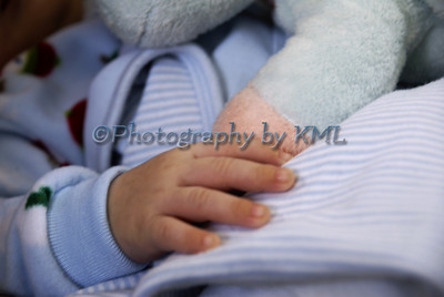 the hand of a baby boy